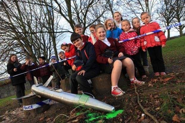 The Advertiser Series: Pupils from St Wilfrid's RC Primary School, Bishop Auckland, investigate UFO crash landing in school field pictured front Nathan Slater, 9, and Olivia Thompson, 9.