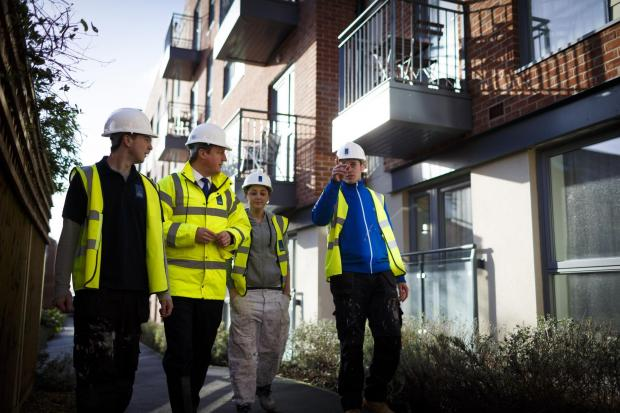 The Advertiser Series: Prime Minister David Cameron chats with apprentices at a new housing development. The Industry Apprentice Council says some apprentices don't feel th