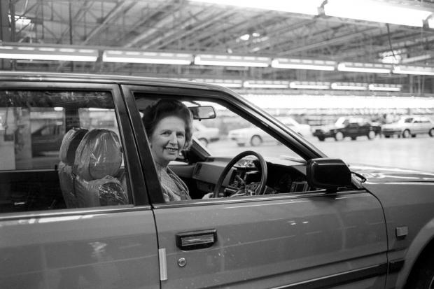 The Advertiser Series: Prime Minister Margaret Thatcher at the wheel of a Bluebird car at Nissan's car plant in 1986