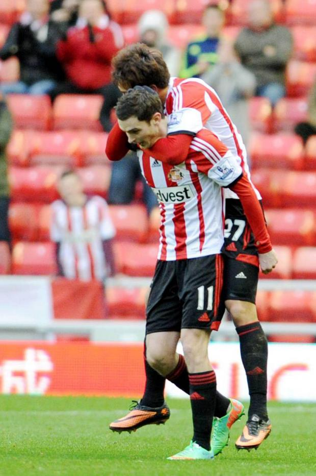 The Advertiser Series: CELEBRATIONS: Adam Johnson is hugged by Ji Dong-Won after firing Sunderland ahead from a free kick to make the score 1-0 during the FA Cup tie against Carlisle yesterday