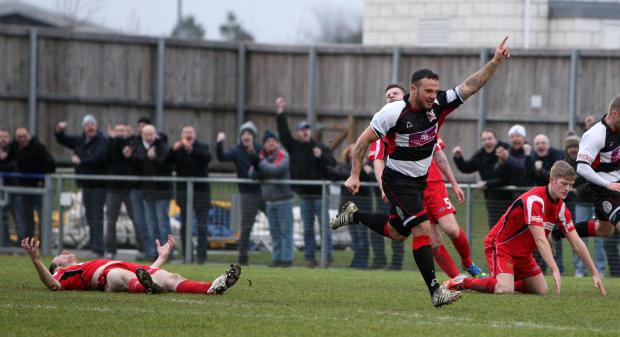 The Advertiser Series: GOOD START: A Clitheroe defender is left flat out as Stephen Thompson celebrates putting Darlington 1-0 after seven minutes