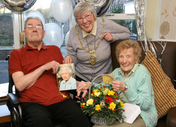 The Advertiser Series: HAPPY COUPLE: Mr and Mrs Mutch celebrate their anniversary with Coun Pauline Charlton