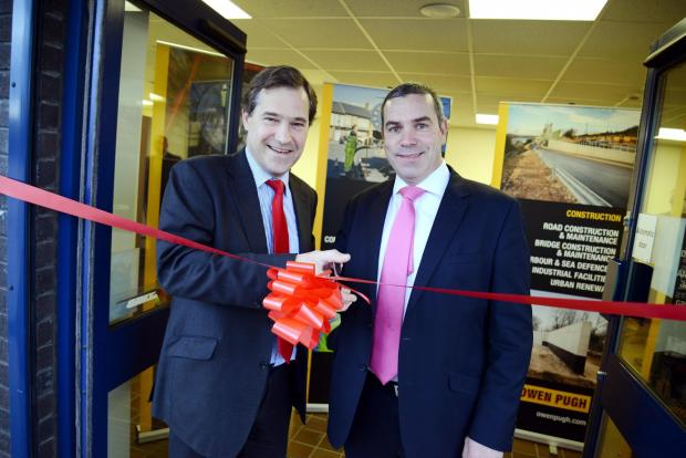 The Advertiser Series: John Dickson, Owen Pugh Group chairman, left, with Andy Parker, HSBC senior corporate banking manager at the opening of the new depot