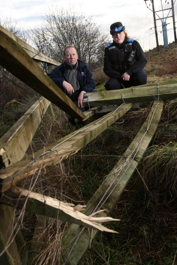The Advertiser Series: FENCE DOWN: Countryside Ranger John Olley and PCSO Mary Hobson with fencing that has been vandalised at Ferryhill Carrs Nature Reserve