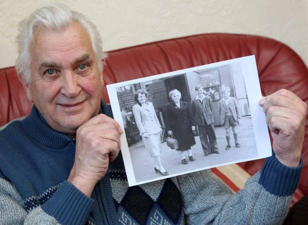 The Advertiser Series: Ian Douglas with a photo of his mother on a family outing