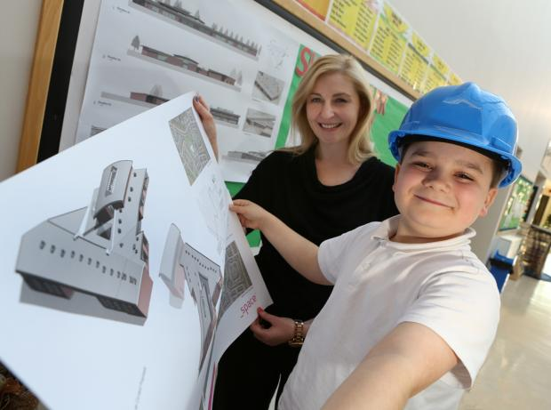 The Advertiser Series: Skerne Park Academy pupil Thomas Dillon with head teacher Kate Chisholm with the development plans when they were first unveiled last week
