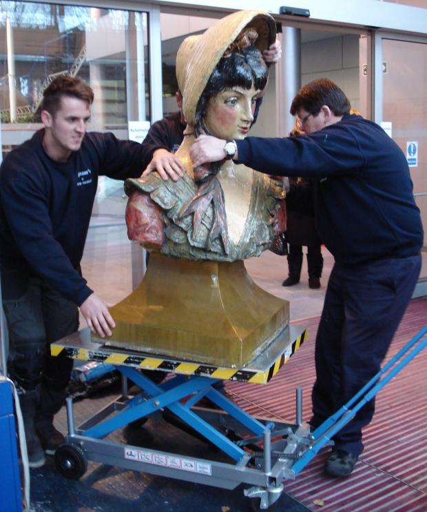 The Advertiser Series: EASY DOES IT: Jake Mulholland and Kevin Rodgers take care moving the half tonne bust of Dainty Dinah.