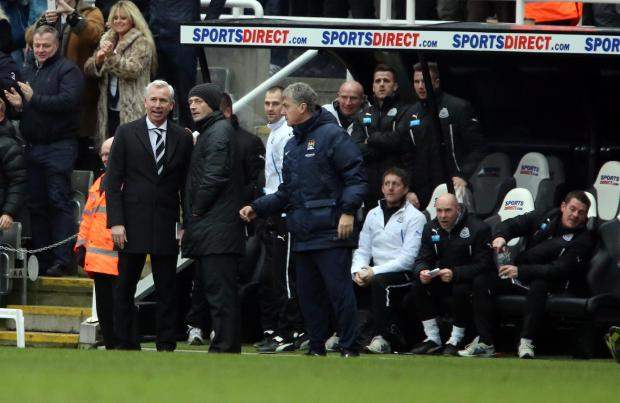 The Advertiser Series: CONTROVERSIAL DECISION: Newcastle manager Alan Pardew consults the fourth official after Cheik Tiote's stunning effort was ruled offside, while Manchester City assistant manager Brian Kidd, looks on