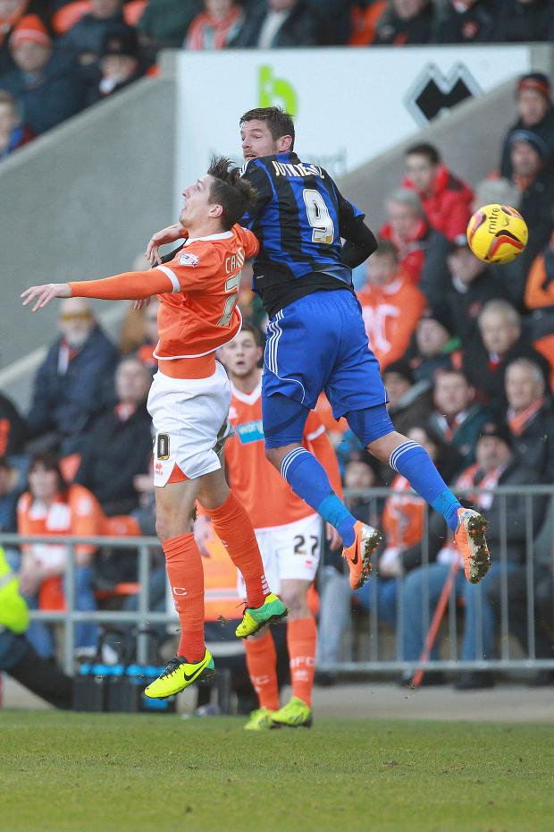 The Advertiser Series: AERIAL BATTLE: Lucas Jutkiewicz and Blackpool's Craig Cathcart contest a header