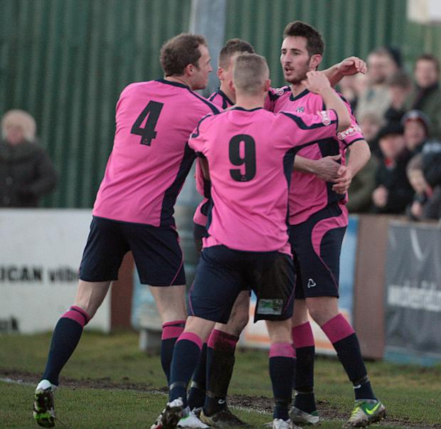 The Advertiser Series: WELCOME RETURN: Joe Tait is congratulated on scoring against Harrogate RA, eight minutes into his return to Quakers