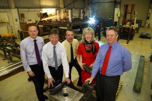 The Advertiser Series: Pictured from left to right are David Lander, from Natwest, Neville Baldry, of Clive Owen and Co, and John Horn, Julie Bates and Brian Bates from Lamba Welding Systems