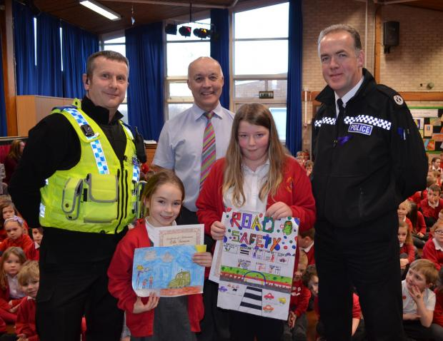 The Advertiser Series: SAFETY FIRST: PCSO Nigel Warby, Thirsk Community Primary School headteacher Richard Wild and Assistant Chief Constable Paul Kennedy congratulate Ella Stimson, seven and Blaney Wardhaugh, ten.