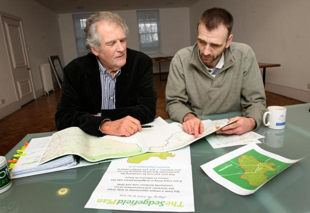 The Advertiser Series: Business man David Bowles (l) and Chris Lines (r) look over the plans for the Sedgefield Plan