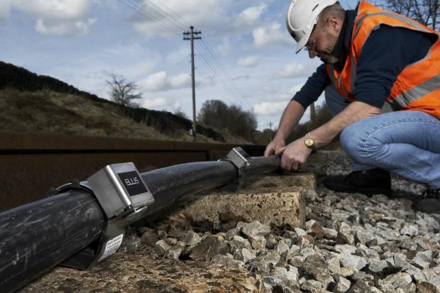 The Advertiser Series: An Ellis worker attaches cleats to a rail line