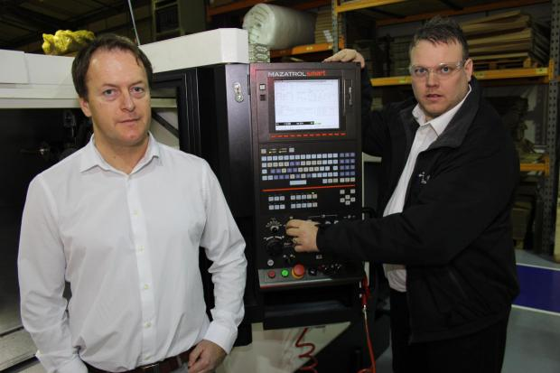 The Advertiser Series: ALM's new production manager Tim Walker (left) and production engineer John Blackburn with the firm's new £160,000 lathe machine.