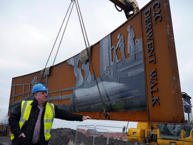 The Advertiser Series: STEEL SCULPTURE: artwork panel is lowered into place