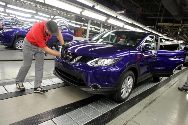 The Advertiser Series: A Nissan worker fits a badge to a Qashqai at its Sunderland plant