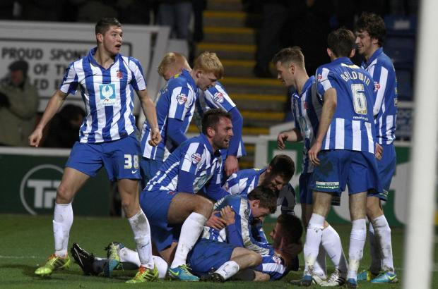 The Advertiser Series: CELEBRATIONS: Pools' players pile on top of Jack Barmby after he put them 2-0 up against visitors York City on Saturday