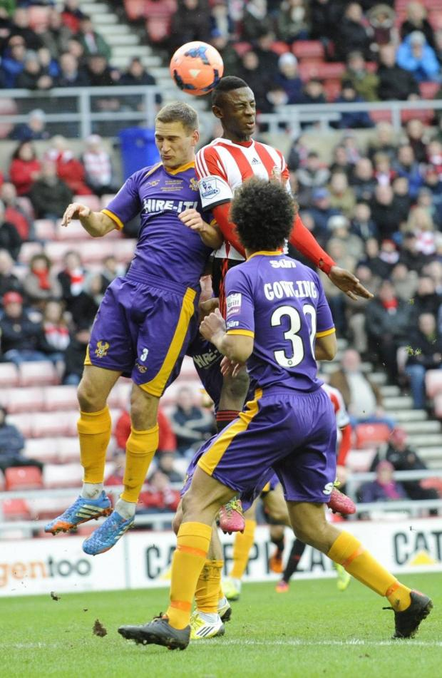 The Advertiser Series: UP FOR THE CUP: Sunderland's El Hadji Ba beats Lee Vaughan to the ball in this aerial challenge