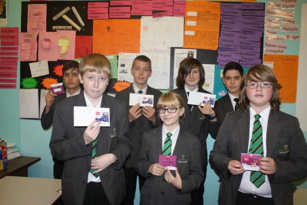 The Advertiser Series: Woodham Academy pupils show off the vouchers t