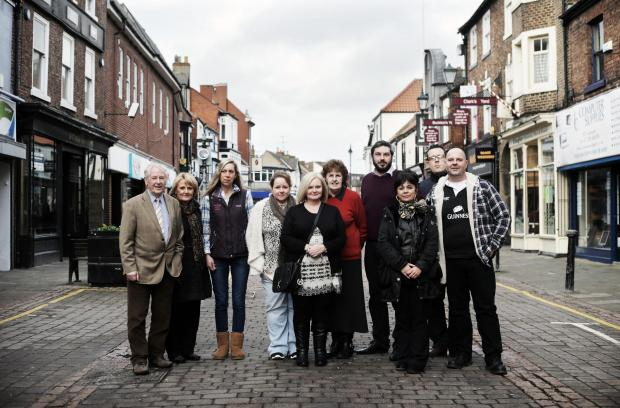 The Advertiser Series: Derek Risbey (far left) and many Skinnergate traders believe that a lack of on-street parking is damaging business