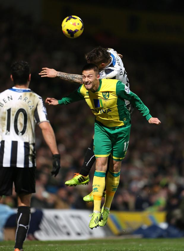 The Advertiser Series: AERIAL BATTLE: Norwich City's Anthony Pilkington and Newcastle United's Mathieu Debuchy vie for the ball last night