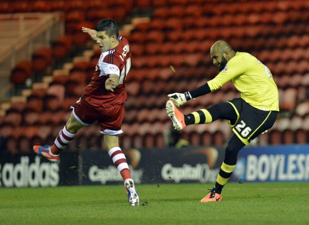 The Advertiser Series: ON THE CHARGE: Middlesbrough's Emmanuel Ledesma charges down a clearance by Wigan Athletic goalkeeper Al Habsi