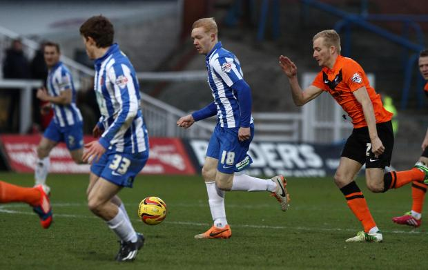 The Advertiser Series: PUSHING ON: Luke Williams, centre, on the attack for Hartlepool against Scunthorpe on Saturday