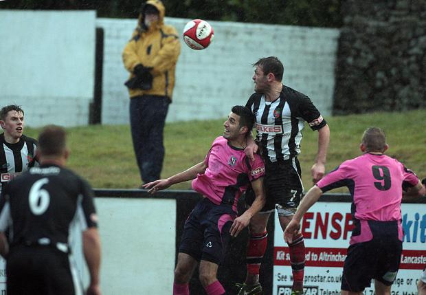 The Advertiser Series: HIGH CHALLENGE: Amar Purewal jumps for the ball with Kendal Town's Ricky Mercer