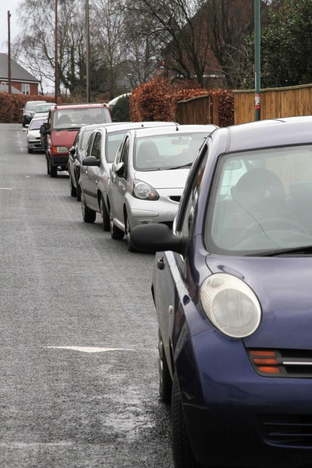 The Advertiser Series: Cars parked on Redhills Lane