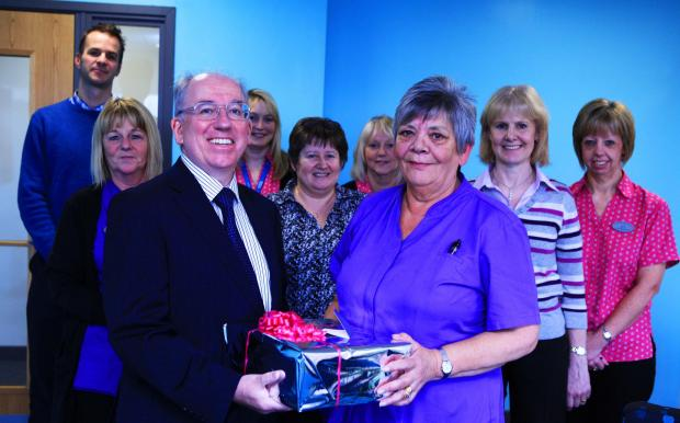 The Advertiser Series: Glynis Eddy is presented with a gift by Dr Tony Long to mark 40-years of service