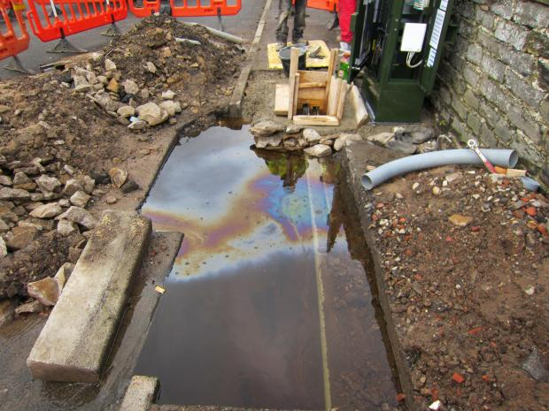 The Advertiser Series: WATER-FILLED HOLE: A hole left by contractors for BT outside Grove House bed and breakfast in Leyburn