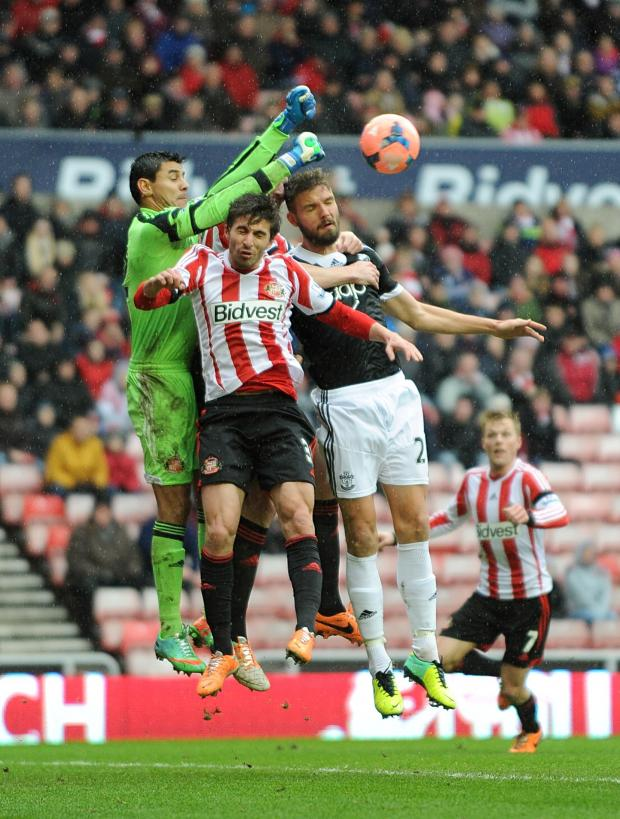 The Advertiser Series: KEEPER'S BALL: Southampton goalkeeper Kelvin Davis punches the ball away from Fabio Borini's challenge