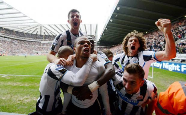 The Advertiser Series: LATE SHOW: Loic Remy is mobbed by team-mates after scoring a last-minute winning goal for Newcastle against Aston Villa yesterday