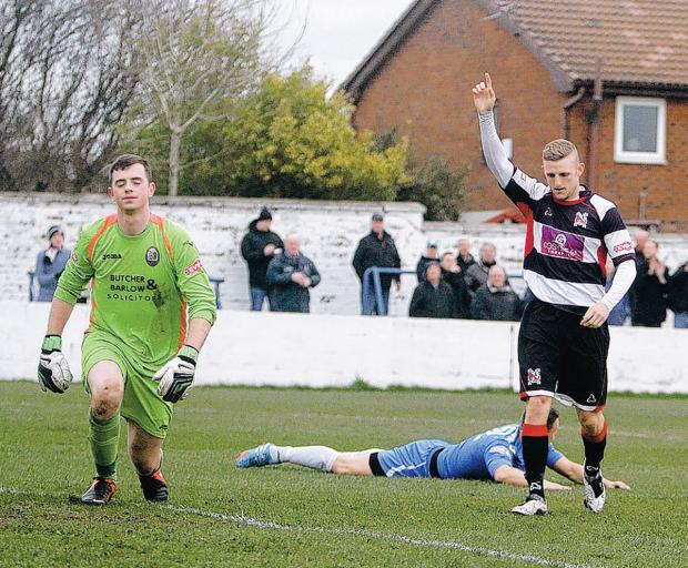 The Advertiser Series: ONE GOAL UP: Radcliffe Borough goalkeeper Chris Cheetham climbs back to his feet as David Dowson celebrates making it 1-0 to Darlington