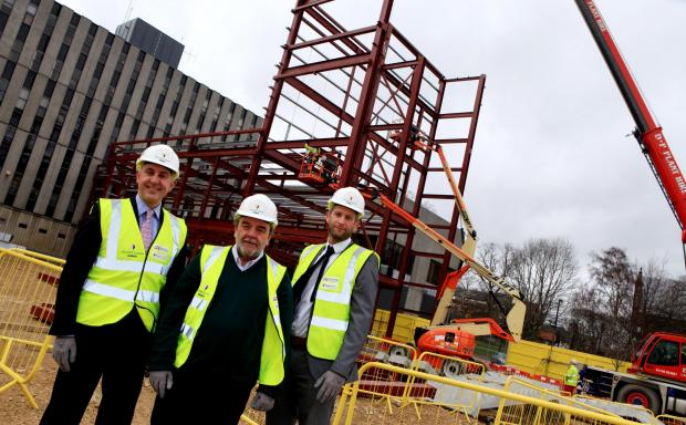 The Advertiser Series: Darlington Borough Council leader Bill Dixon, centre, with Andrew McCully, left, of the Department for Education and project manager Shaun McNicholas, of building contractor Willmott Dixon