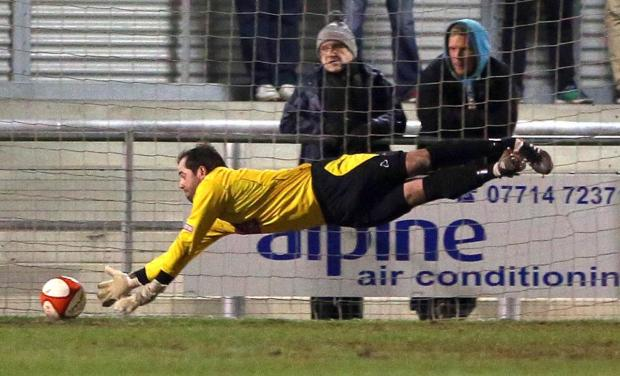 The Advertiser Series: BELLY FLOP: Darlington goalkeeper Mark Bell dives full-stretch but cannot keep Tom Kilfin's shot out