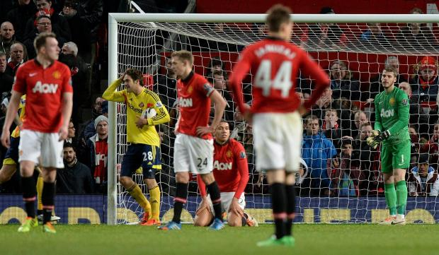 The Advertiser Series: Manchester United's David De Gea shows his dejection after his mistake lead to Sunderland's equalising goal during the Capital One Cup, Semi Final, Second Leg at Old Trafford, Manchester