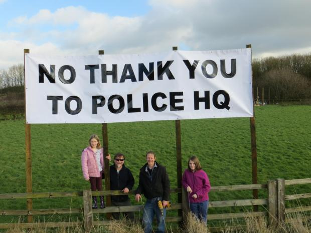 The Advertiser Series: 1.	Village protesters Mick Lynas (left) and John House are joined by Mr Lynas's daughters Alex, nine, and Eve, 13, when the protest banner was erected.