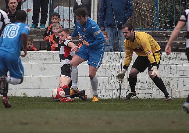 The Advertiser Series: ROUTE BLOCKED: Darlington's Jordan Robinson and keeper Mark Bell thwart a Radcliffe Borough attack. Picture: Les Hodge