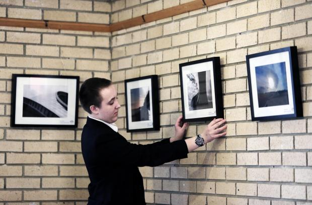 The Advertiser Series: PICTURE PERFECT: 15 year old Jonathon Myers of Belmont School hangs his print in the visitors centre at Durham's Botanical Garden