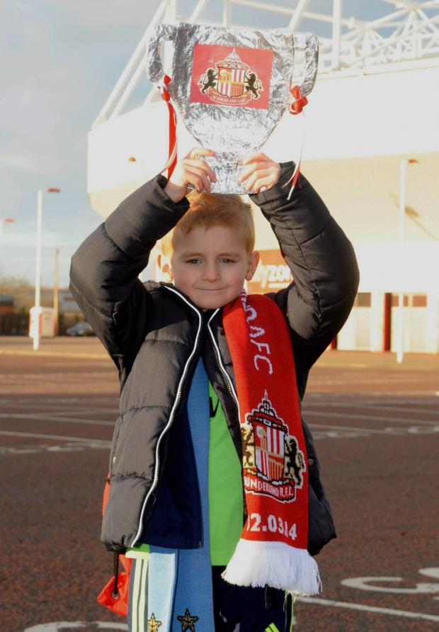 The Advertiser Series: Kieron Davis, five, among the excited Sunderland fans who arrived early at The Stadium of Light this morning (Sat) as they set off on the long road to Wembley ahead of tomorrow's Capital One Cup final against Manchester City.
