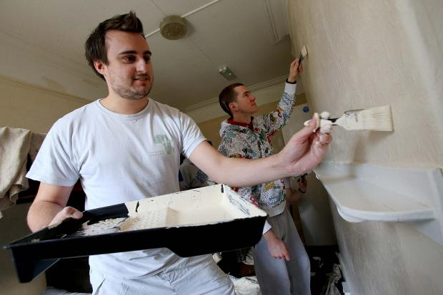 The Advertiser Series: Volunteers Jonny Crick (25) and Sean McCrystal (25) from Beamish Football Club help with the redecorat