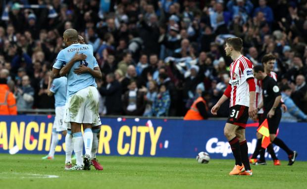 The Advertiser Series: MIXED FORTUNES: Sunderland striker Fabio Borini, scorer of the first goal, looks on as Vincent Kompany hugs Samir Nasri, who had put Manchester City into a 2-1 lead