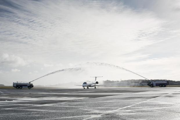 The Advertiser Series: The aircraft touches down at Newcastle International Airport and is welcomed by a guard of honour water salute from the airport fire service
