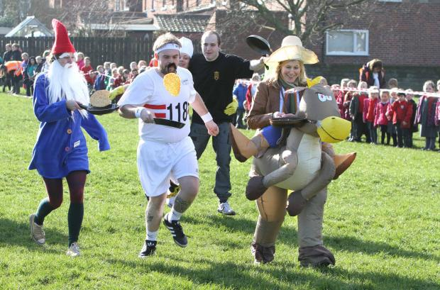 The Advertiser Series: Competitors in the fancy dress section of Northallerton's annual Shrove Tuesday pancake races.