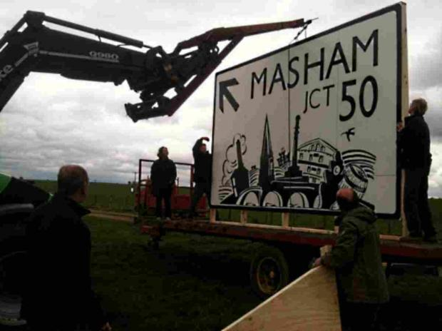 The Advertiser Series: The DIY sign is put up in a field by the side of the A1 last May