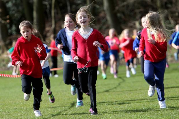 The Advertiser Series: FUN RUN: Children taking part in the event at Maiden Castle