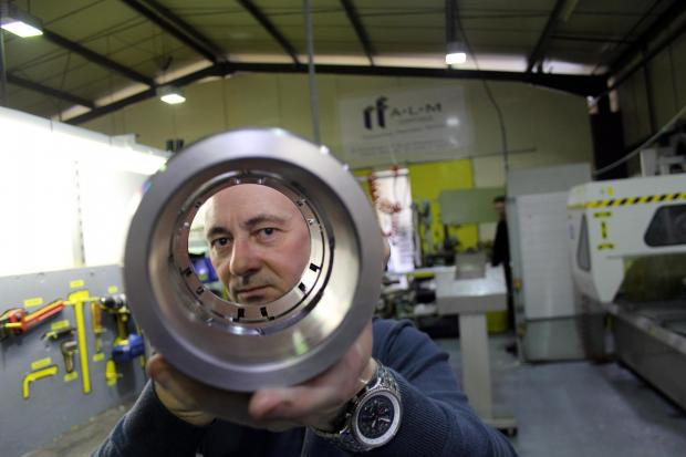 The Advertiser Series: ALM's quality engineer Trevor Wright holds a component, made by the firm's new £160,000 lathe, for the oil and gas sector