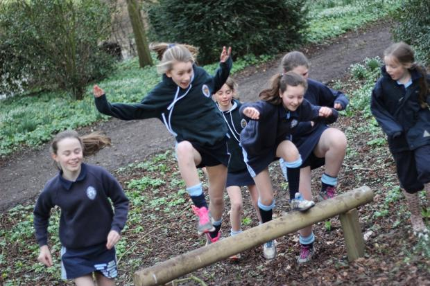 The Advertiser Series: Pupils at Queen Mary's School test out the Wolf run assault course.